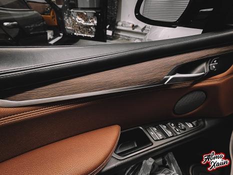 BMW X5. Перетяжка руля и центрального тоннеля, аквапринт _8