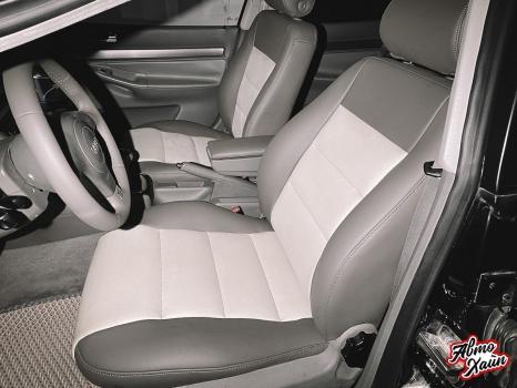 Audi A4. Перетяжка передних сидений, руля и подлокотника_3