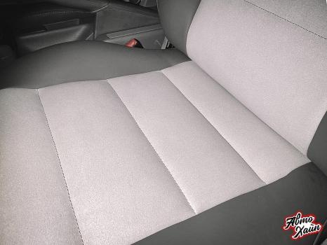 Audi A4. Перетяжка передних сидений, руля и подлокотника_5