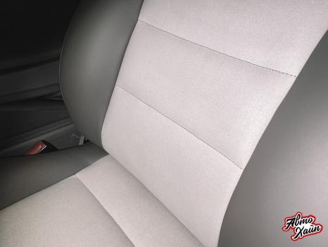 Audi A4. Перетяжка передних сидений, руля и подлокотника_6